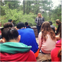 Alison Wood, Tucson Borderlands Site Coordinator, leading a reflection at Montlure Church Camp